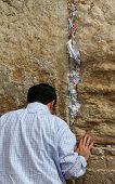 Jewish Worshiper Pray At The Wailing Wall An Important Jewish Religious Site   In Jerusalem, Israel.