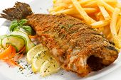 Fish dish - fried fish, French fries and vegetables
