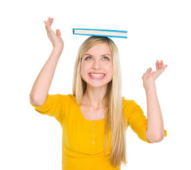 picture of peppy  - Happy student girl balancing book on head - JPG