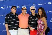 MOOREPARK, CA - SEPT 16:  Scott Medlock, Myrna Medlock, Robby Krieger and guest arrive at the 6th Annual Medlock & Krieger Golf Invitational & All-Star Concert on Sept. 16, 2013 in Moorepark CA.