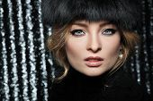 Portrait of beautiful sexual blonde in a fur cap
