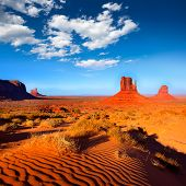 stock photo of arid  - Monument Valley West and East Mittens Butte desert sand dunes Utah - JPG