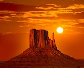 Monument Valley West Mitten at sunrise sun orange sky Utah photo mount