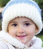 Young child, girl, in woolly hat, close up.