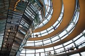 BERLIN, GERMANY - JULY 21, 2013:Tourists inside the glass dome of the Reichstag in Berlin, Germany; July 21, 2013
