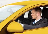 transportation and vehicle concept - businessman or taxi driver driving a car