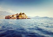 Sveti Stefan, small islet and resort in Montenegro. Balkans, Adriatic sea, Europe. Beauty world. Tilt-shift effect