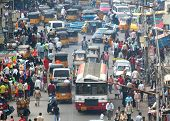 HYDERABAD, ANDHRA PRADESH, INDIA - AUGUST 29: Shoppers and traffic weave about the busy bazaar at th