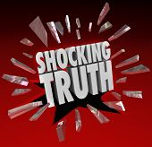 stock photo of bombshell  - The words Shocking Truth breaking through red glass to illustrate a surprise - JPG