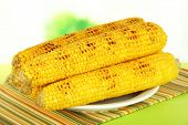 stock photo of maize  - Delicious golden grilled corn  on table on bright background - JPG