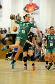 SIOFOK, HUNGARY - SEPTEMBER 14: Agnes Hornyak (green 31) in action at a Hungarian Championship handball match Siofok KC (black) vs. Gyori Audi ETO KC (green), September 14, 2013 in Siofok, Hungary.
