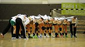 SIOFOK, HUNGARY - SEPTEMBER 14: Gyor players at a Hungarian National Championship handball match Siofok KC (black) vs. Gyor (green), September 14, 2013 in Siofok, Hungary.