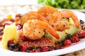 dish of fried shrimps with avocado, figs and berries sauce-shallow DOF