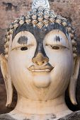 image of chums  - Head detail of old Buddha statue in the Wat Si Chum temple in Sukhothai historic park - JPG