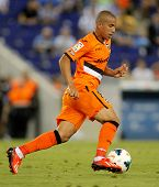 BARCELONA - AUG, 24: Sofiane Feghouli of Valencia CF in action during a Spanish League match against RCD Espanyol at the Estadi Cornella on August 24, 2013 in Barcelona, Spain