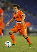 BARCELONA - AUG, 24: Andres Guardado of Valencia CF in action during a Spanish League match against RCD Espanyol at the Estadi Cornella on August 24, 2013 in Barcelona, Spain