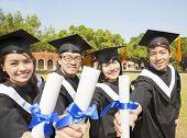 Happy College Graduate Show Diplomas