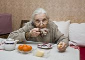 Old Lady Drinking Tea