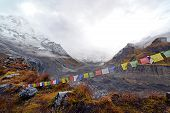 stock photo of sherpa  - Cloudy weather and storm in the Annapurna Base Camp - JPG