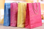 Colorful shopping bags, on  bright background