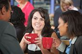 Grinning Woman With Coffee And Coworkers