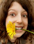 Cheerful Girl And Yellow Camomile