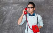 Young Asian Man Portrait With Telephone