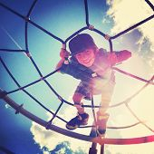 stock photo of playground school  - Boy playing at the park with instagram effect - JPG