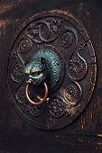 Antique Knocker On A Wooden Door, Augsburg, Germany