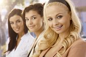 Close-up portrait of pretty businesswomen outdoors. Selective focus.