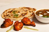 Paratha With Paneer Masala And Chicken Kebab.