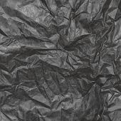 Crumpled  Paper Background Texture. Vintage Craft Paper Texture Dark Grey Color. Background Of Kraft