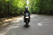 Motorcyclist Goes On Road, Front View