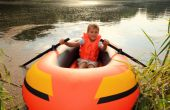Boy In Inflatable Boat In Water