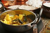 image of brinjal  - Cauliflower Brinjal Curry is made with fresh vegetables and spices and served with rice and roti - JPG