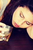 Yound beautiful woman in depression, drinking alcohol