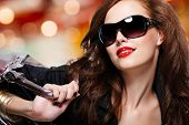 picture of black face  - Face of fashion luxury woman in black trendy sunglasses with handbag - JPG