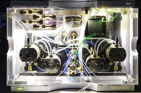 stock photo of hplc  - close up shot of the insides of a HPLC module in a real life laboratory - JPG