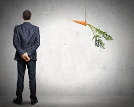 foto of dangling a carrot  - Funny image of businessman chased with carrot - JPG