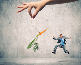 image of dangling a carrot  - Funny image of businessman chased with carrot - JPG