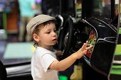 Child Playing Arcade Game Machine