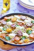 Pizza with cherry tomatoes, pepper, olives and mozzarella