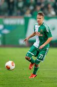 VIENNA, AUSTRIA - AUGUST 22 Louis Schaub (#21 Rapid) runs with the ball at a UEFA Europa League game