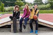 Teenagers Thumbs Up At Skatepark