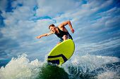 Male surfer riding on board in summer