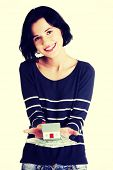 foto of zloty  - Happy woman holding polish zloty bills and house model over white  - JPG