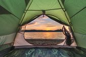 green tent on lake coastline closeup