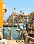 Attractive Girl  On A Bridge In Venice, Italy
