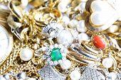 stock photo of precious stone  - Closeup of gold jewelry with precious stones - JPG