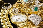foto of precious stone  - Closeup of gold jewelery with precious stones - JPG